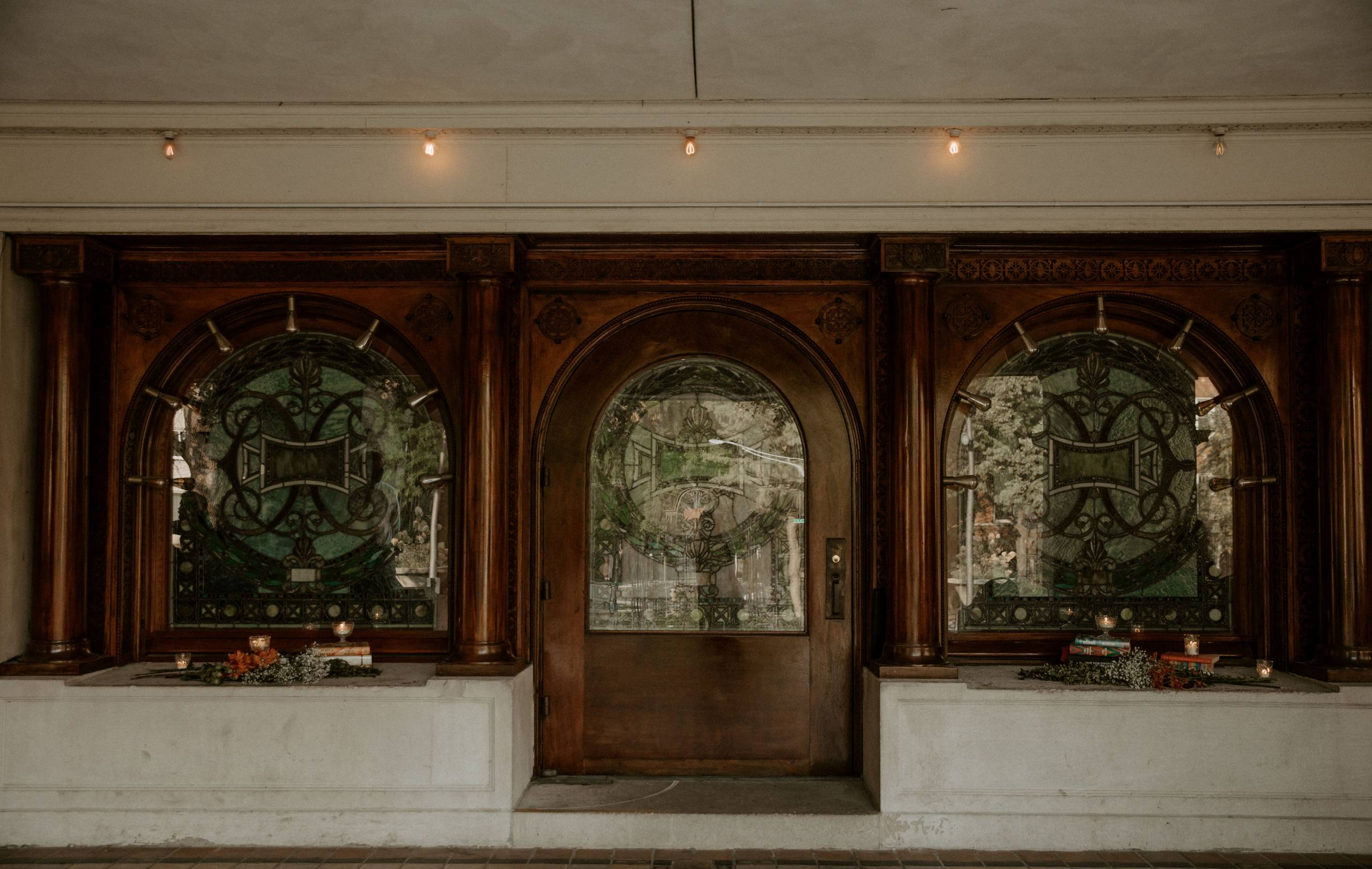 View of the Stained Glass Windows and Entry Door of Pleasant Home dressed up for a wedding