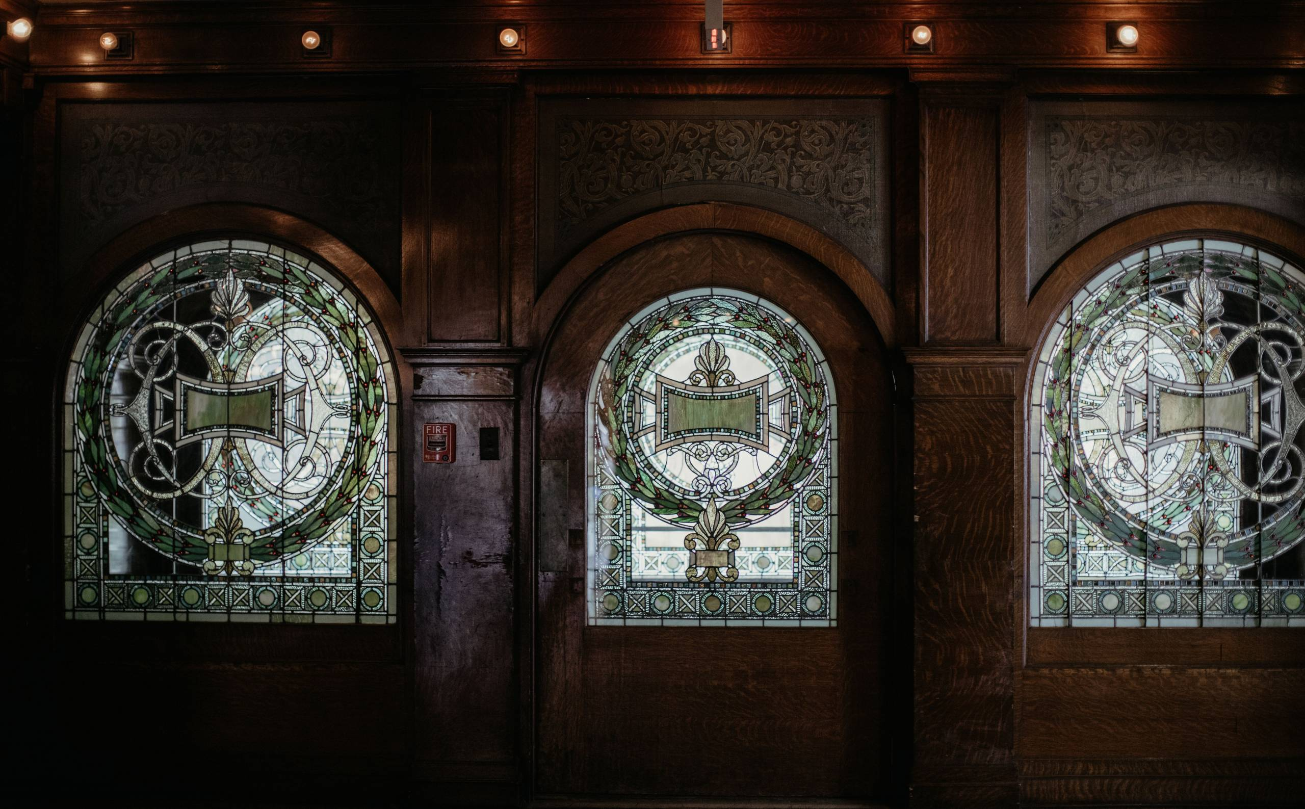 Exquisite View of Pleasant Home Stained Glass Door and Windows in the Front Hall
