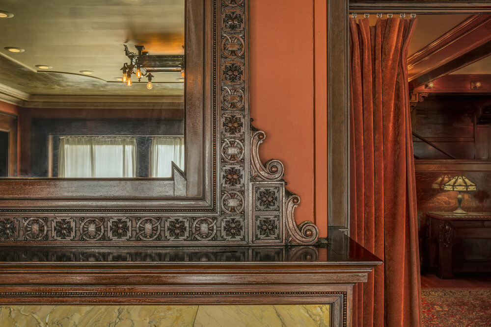 Corner detail of mirror above fireplace at Pleasant Home